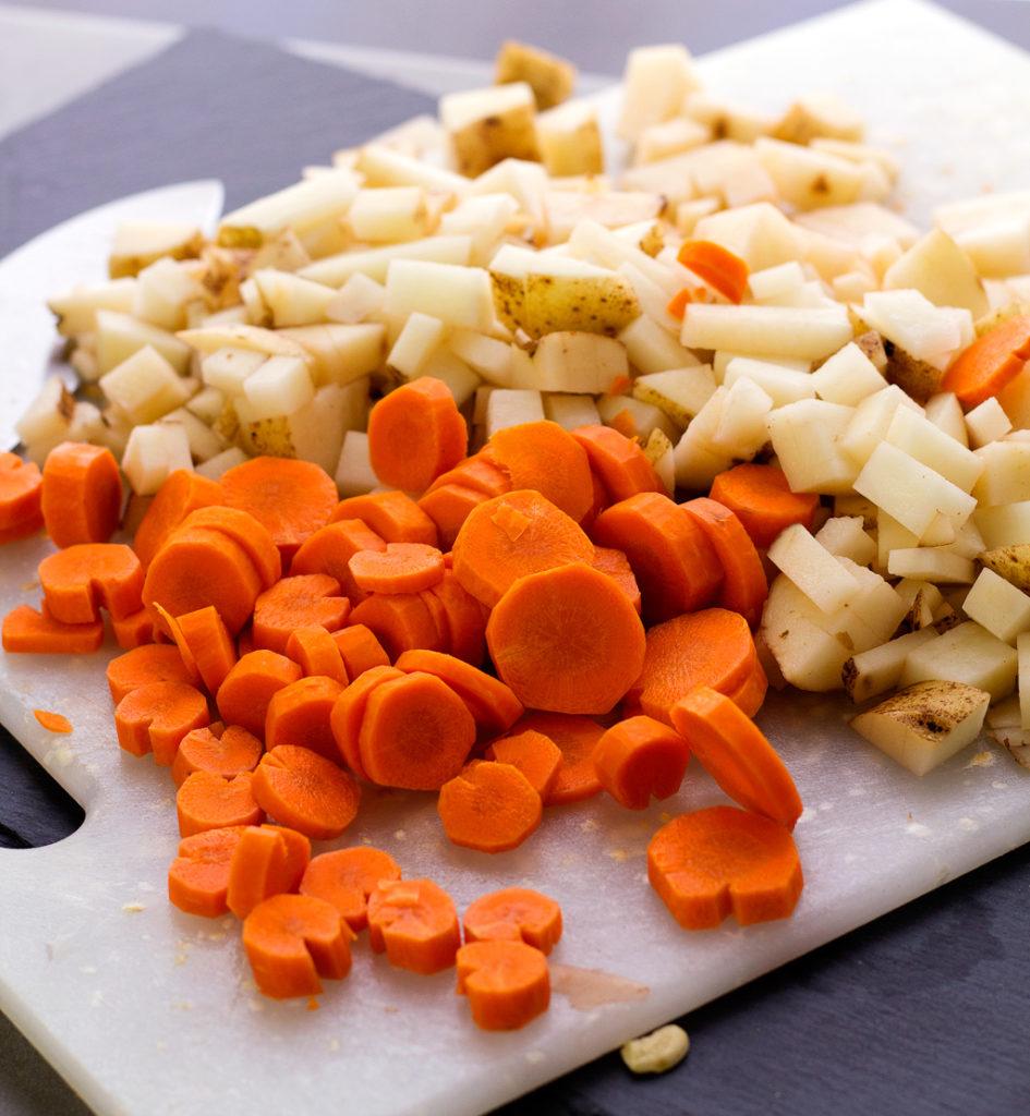 cut potatoes and carrots for vegan creamy potato soup recipe