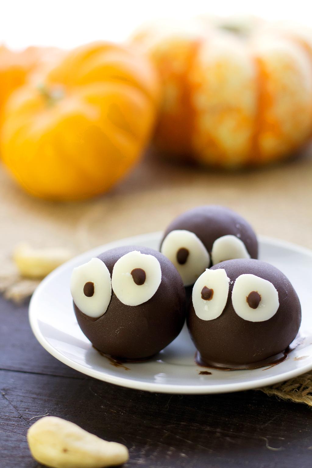 Close-up of vegan pumpkin spice truffles. Made with dates, cashews, rolled oats, and hemp seeds!