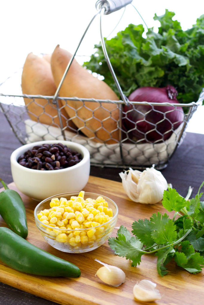 ingredients for vegan stuffed sweet potatoes with black beans and kale
