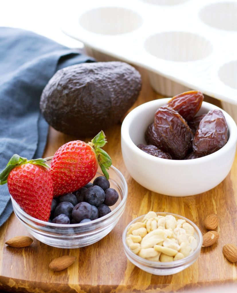 Vegan chocolate cheesecake ingredients- berries, cashews, almonds, dates and berries!