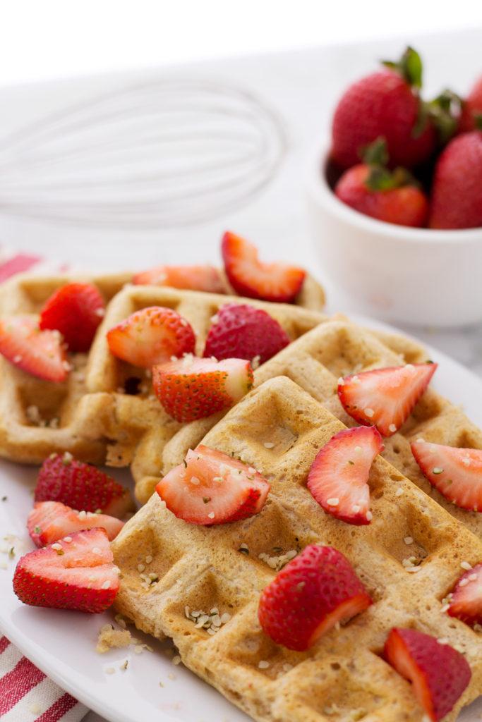 Adding strawberries and hemp seeds to easy vegan waffle recipe