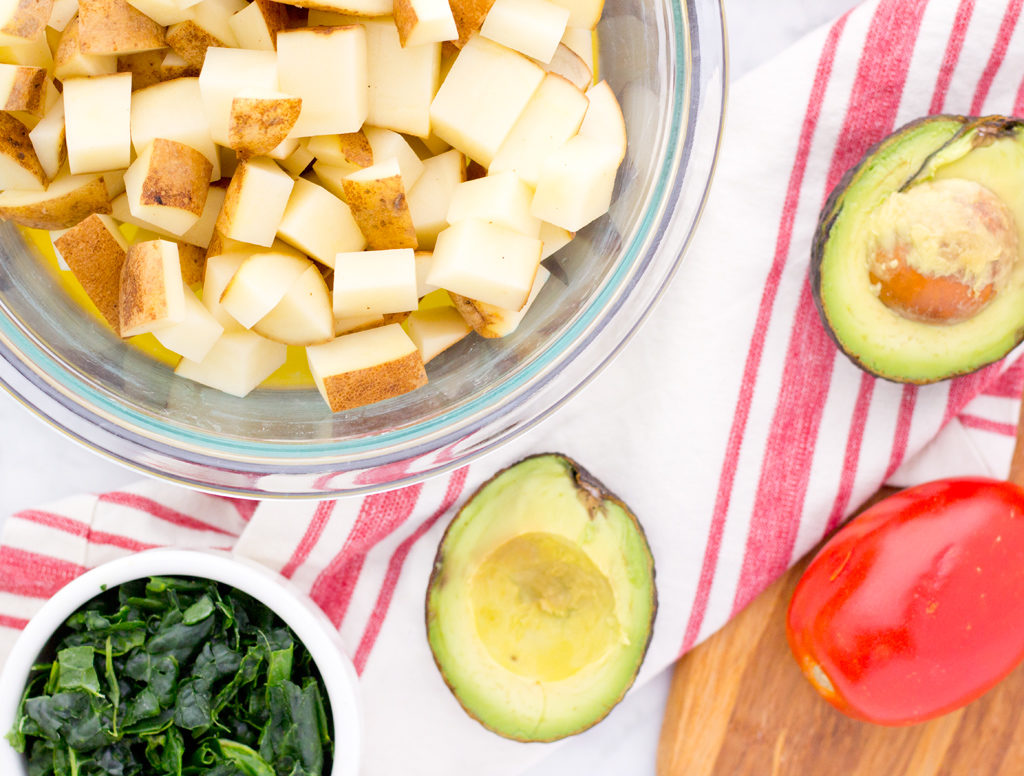 Cut potatoes and kale for vegan breakfast burrito recipe